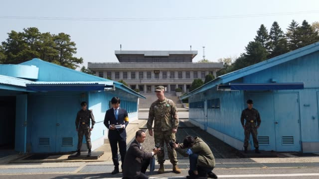 united nations command representative speaks to the media in the truce village of panmunjom inside the demilitarized zone separating the south and... - security code stock videos and b-roll footage