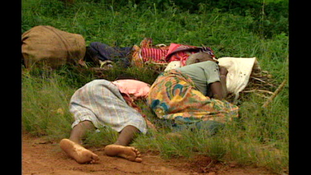 united nations courts jail architect of rwandan genocide 1051994 kigali various shots of dead bodies lying along roadside and in road - genocide stock videos & royalty-free footage
