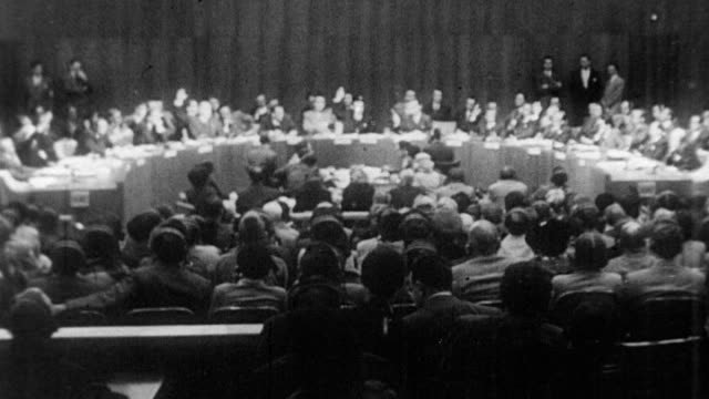 stockvideo's en b-roll-footage met united nations general assembly meet to adopt resolution 377 / security council representatives sit in a semi circle / rest of the general assembly... - koreaanse oorlog