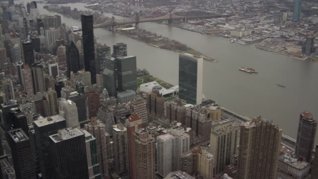 aerial united nations headquarters and east river, new york city, new york, usa - united nations stock videos & royalty-free footage