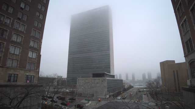 united nations headquarters in manhattan new york city. architects: wallace harrison, oscar niemeyer, le corbusier. opened in 1952. low angle view on... - globe navigational equipment stock videos & royalty-free footage