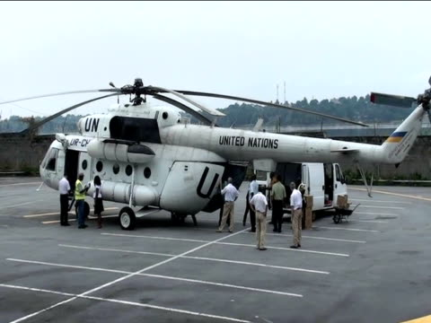 united nations helicopter delivers supplies and protection to elected ivory coast president alassane ouattara as incumbent leader laurent gbagbo... - côte d'ivoire stock videos & royalty-free footage
