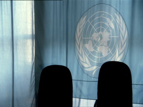 ms united nations logo on curtains and empty chairs in unamir meeting room / kigali, rwanda  - vereinte nationen stock-videos und b-roll-filmmaterial
