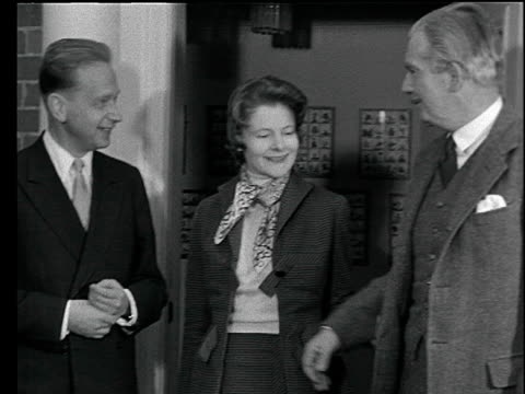 united nations secretary general dag hammerskjold poses for press with prime minister anthony eden and wife england jan 55 - politik und regierung stock-videos und b-roll-filmmaterial