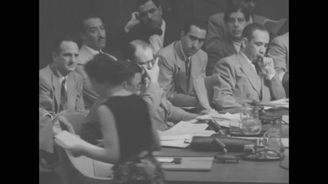 united nations security council officials and their aides delegates behind table, president benegal narsing rau of india calls for a show of hands,... - documentary footage stock videos & royalty-free footage