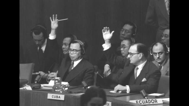united nations security council president ales bebler of yugoslavia asks members who are in favor of the resolution to raise hands, bebler raises... - bomba atomica video stock e b–roll