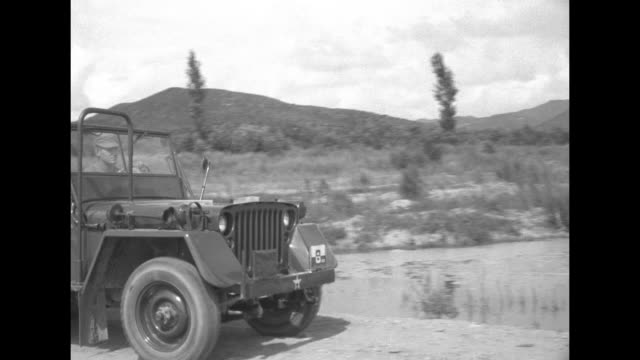 vs united nations soldiers stand on road near jeeps watching united states army helicopters land on road / soldiers walk from jeep toward river... - pontoon bridge stock videos and b-roll footage
