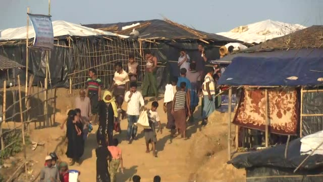 United Nations urge for help to deal with Rohingya refugee crisis BANGLADESH Kutupalong EXT Soldier pushing Rohingya refugees back from aid truck Bag...