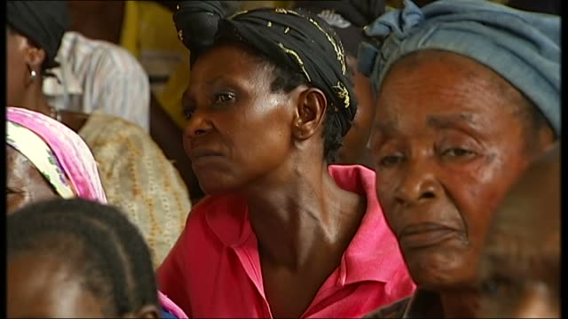 united nations visit to meet victims of rape kampala village int village women gathered in village hall / men leaning through window / shots of... - kampala stock videos & royalty-free footage