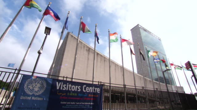 cu of united nations visitors centre sign / new york, united states - united nations building stock videos and b-roll footage