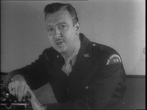 vídeos de stock e filmes b-roll de united press correspondent walter cronkite at a desk typing on a typewriter / an american reporter retells his story about occupation in the north... - 1942