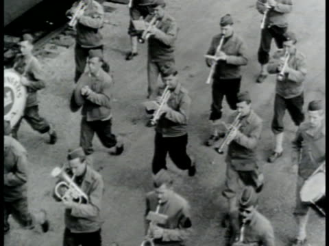 stockvideo's en b-roll-footage met united stated us army brass band playing walking in street vs us army soldiers boarding passenger train one soldier in group yawning male porter... - 1943
