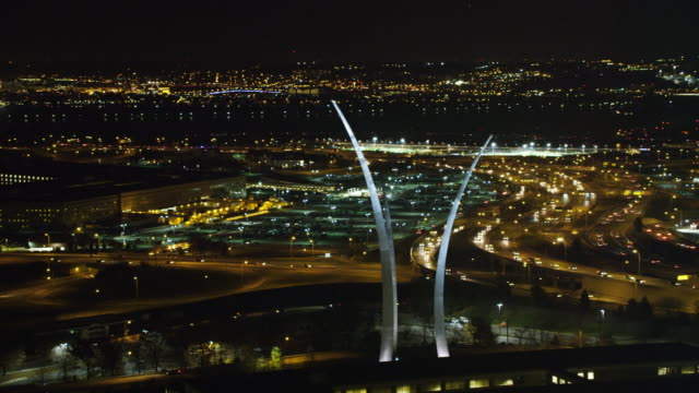 united states air force memorial in arlington, virginia; potomac river and washington dc in background, night view. shot in 2011. - fort myer stock videos and b-roll footage