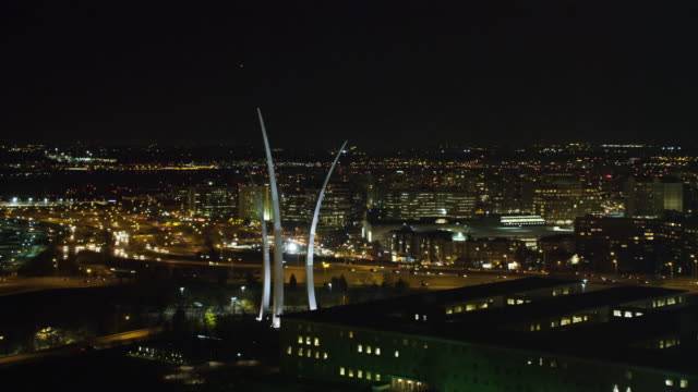 united states air force memorial in arlington, virginia; potomac river and washington dc in background, night view. shot in 2011. - arlington virginia video stock e b–roll