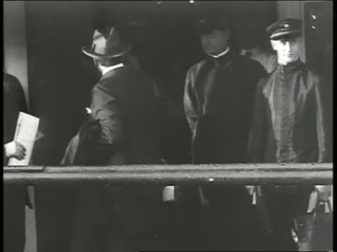 united states ambassador to germany james w gerard holding coat luggage standing at ship's railing walking off ship's ramp standing w/ woman most... - 1917 stock-videos und b-roll-filmmaterial