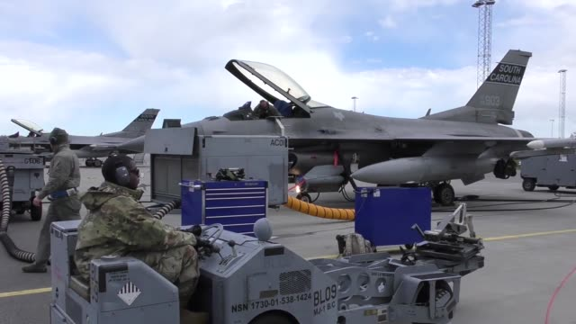 stockvideo's en b-roll-footage met united states and european aircraft conduct flight operations in support of arctic challenge exercise at kallaz air base sweden 30 may 2019 aircraft... - britse leger