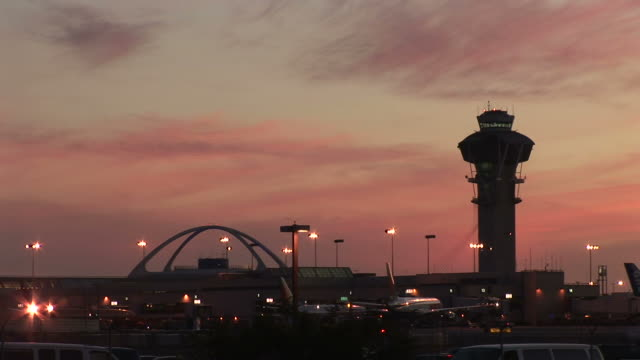 united states, california, los angelesairport control tower in los angeles - torre di controllo video stock e b–roll