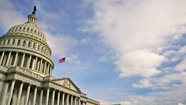 united states capitol. american flag in the sky. grand majestic view. clouds in sky. - senate stock videos & royalty-free footage