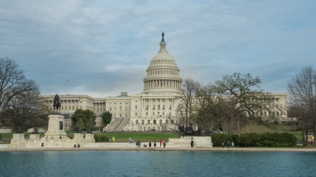 united states capitol building in washington, dc - governo video stock e b–roll