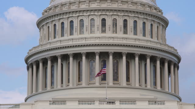 united states capitol dome and american flag - close up in 4k/uhd - legislator stock videos & royalty-free footage