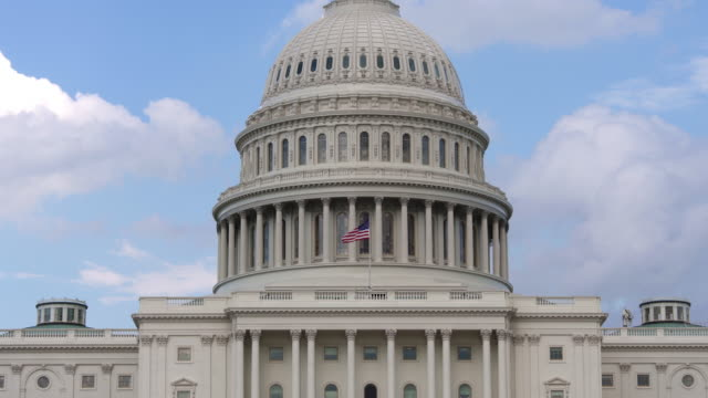 United States Capitol Dome and American Flag - Zoom In - 4k/UHD