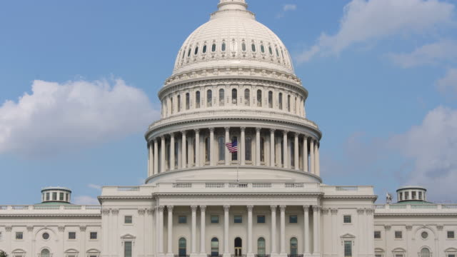 United States Capitol Dome and American Flag - Zoom Out in 4k/UHD
