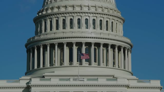 united states capitol dome close up and american flag in washington, dc - united states senate stock videos & royalty-free footage