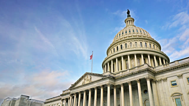 united states capitol skyline in washington dc. american flag - politische wahl stock-videos und b-roll-filmmaterial