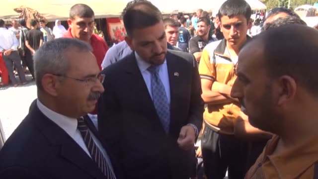 united states consulate adana john espinoza visits iraqi yezidi refugees fled their home due to the violence of armed groups led by islamic state... - silopi stock videos and b-roll footage