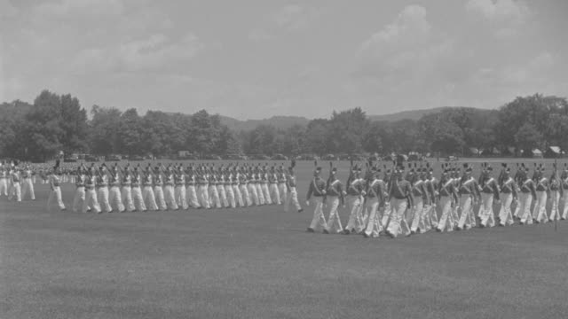 WS United States Corps of Cadets (U.S.C.C.) marching in open field at West Point