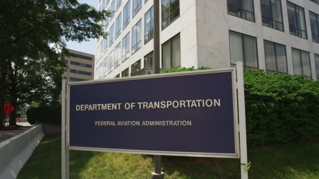 united states department of transportation sign at corner of indiana avenue and 6th street in washington dc, looking down indiana avenue. shot in may 2012. - politics stock-videos und b-roll-filmmaterial