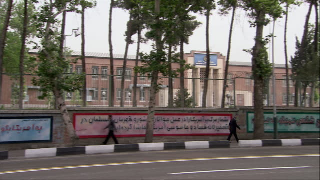 ws pan united states embassy with street in foreground, tehran, iran - us embassy stock videos & royalty-free footage