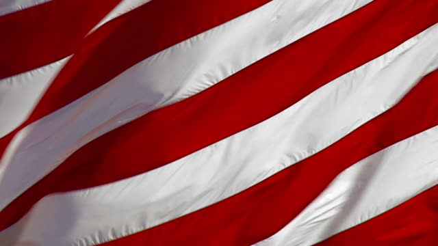 """united states flag"" slow motion. also see: - flag blowing in the wind stock videos & royalty-free footage"