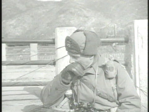 stockvideo's en b-roll-footage met united states lieutenantgeneral matthew ridgway looking out w/ binoculars standing talking w/ other officers south korea us eighth army not ridgeway - south korean army
