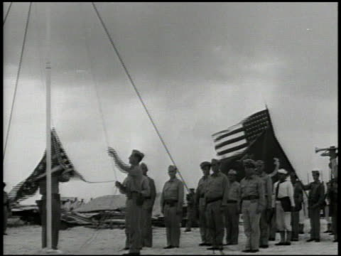 united states major colonel walter baylor arriving on wake island various japanese soldiers standing at attention us soldiers raising american flag... - japanese surrender stock videos and b-roll footage