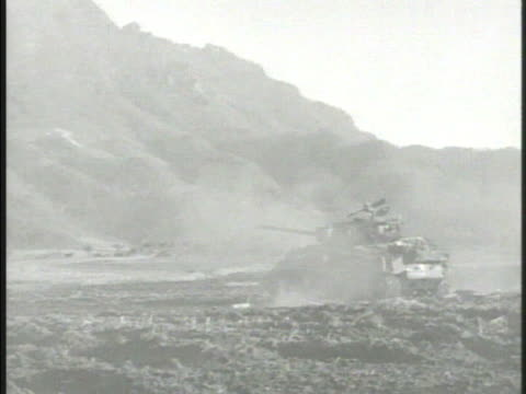 united states marine artillery regiment firing cannons vs us m4 sherman tanks firing explosion in distance soldiers standing on field 38th parallel - regiment stock videos and b-roll footage