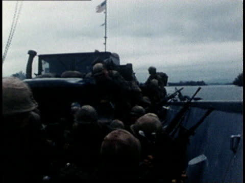 vidéos et rushes de united states marine corps grunts moving up the river in small boats during vietnam war tet offensive / south vietnam - 1968