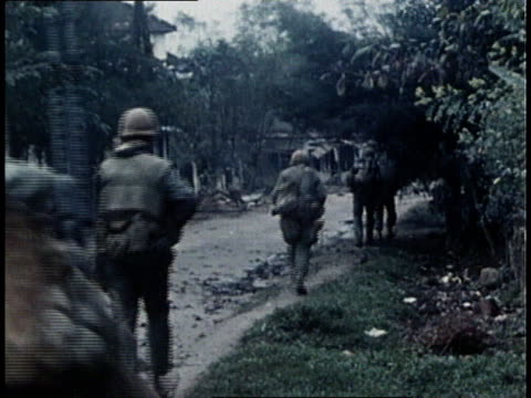 united states marine corps urban fighting near the imperial palace during the vietnam war tet offensive / hue city south vietnam - south vietnam stock videos & royalty-free footage