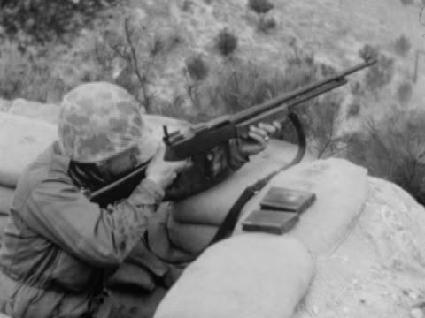 united states marine in defensive position firing m1918 browning automatic rifle , reloading w/ cartridges. korea, infantry, defense, korean conflict - us marine corps stock videos & royalty-free footage