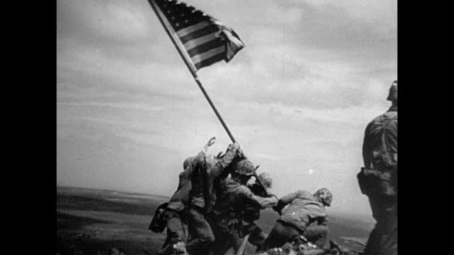 united states marines & 1 navy corpsman raising the american flag atop mount suribachi, american flag flying. - iwo jima island stock videos & royalty-free footage