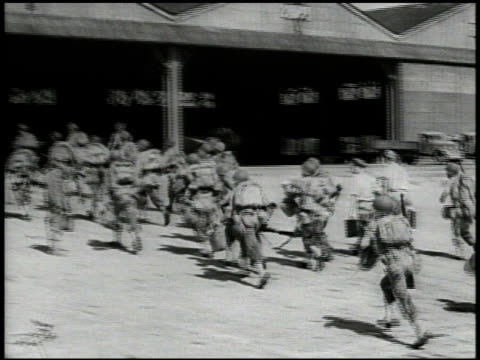 United States Marines 6th Division arriving on beach shores via landing craft moving onto base VS US amp Japanese officers talking outside Marines...