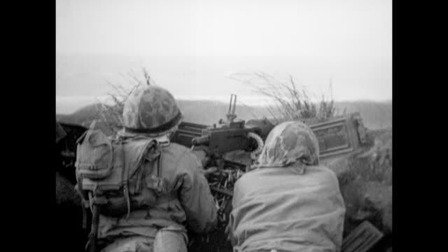 vs united states marines advancing on northern iwo jima including m4 sherman tanks marines on rocky ridge firing machine guns throwing grenades... - battle of iwo jima stock videos & royalty-free footage