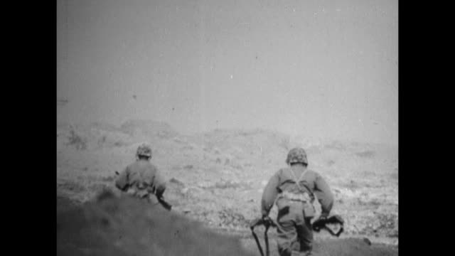 vs united states marines advancing on northern iwo jima including m4 sherman tanks marines on rocky ridge firing machine guns throwing grenades... - schlacht um iwojima stock-videos und b-roll-filmmaterial