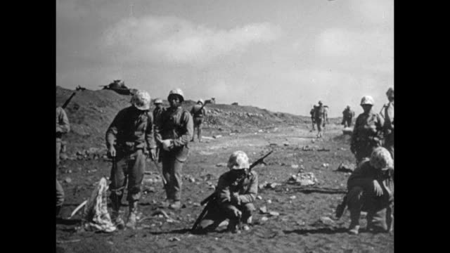 united states marines along beach clearing checking for mines prodding poking sand w/ knives - battle of iwo jima stock videos & royalty-free footage
