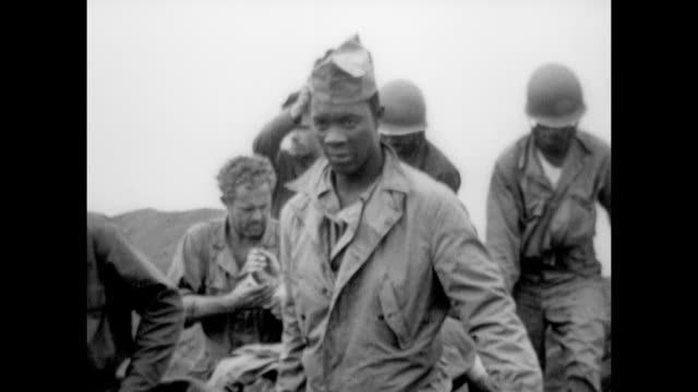 vs united states marines carrying wounded on stretcher in field of debris medics tending wounded holding up blood plasma carrying injured into... - schlacht um iwojima stock-videos und b-roll-filmmaterial