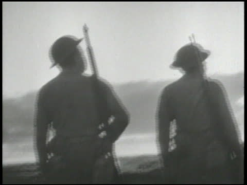 united states marines on guard on lookout along coast of midway island ms silhouette of soldier standing watch dock waters bg battle of midway world... - battle stock videos & royalty-free footage