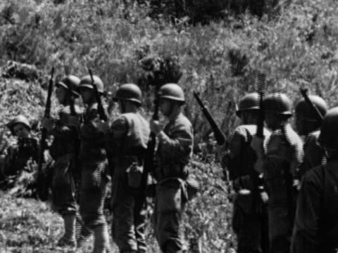 united states marines standing at military burial ceremony soldiers firing rifles in volley salute bugler playing bugle korea cemetery korean conflict - bugle stock videos and b-roll footage