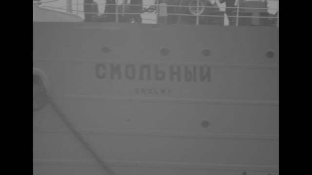 united states military police officer stands near jeep as the soviet ship smolny enters harbor in tokyo carrying eight japanese soldiers to be... - 将校点の映像素材/bロール