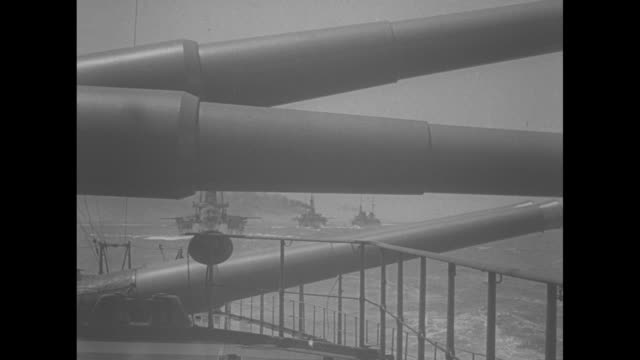 united states navy entering the dardanelles / mls ship's gun barrels in foreground, line of ships trailing in background - middle east stock videos & royalty-free footage