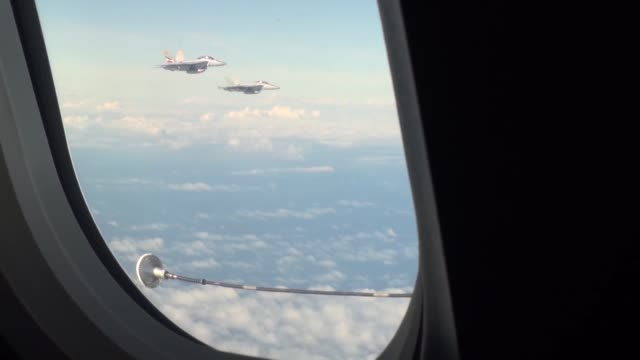 united states navy f/a18 hornets are refueled by a 437 transportation squadron cc150t polaris strategic airtoair refueler based out of 8 wing trenton... - afterburner stock videos and b-roll footage